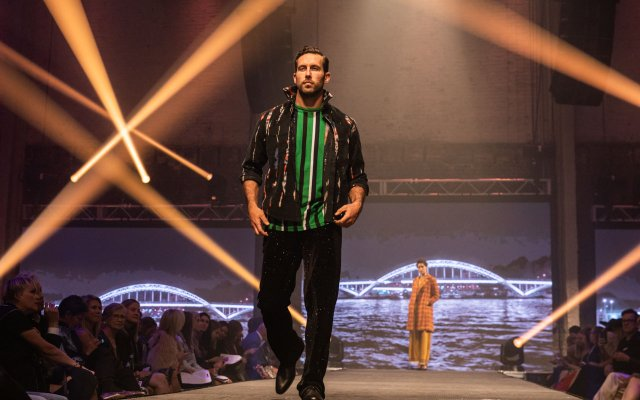 Fashionopolis 2019: man wearing black pants, striped top, and jacket
