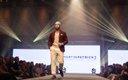 Fashionopolis 2019: man on runway wearing khaki pants, brown sweater and brown jacket