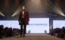 Fashionopolis 2019: man on runway wearing black suit and red overcoat