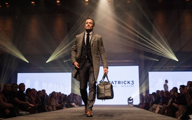 Fashionopolis 2019: man on runway wearing dark plaid suit and tweed coat