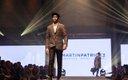 Fashionopolis 2019: man on runway wearing brown pants with brown plaid jacket