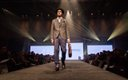 Fashionopolis 2019: man on runway wearing grey pant and vest with brown single-breasted jacket