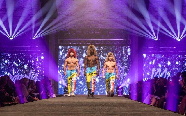 three men on runway at Fashionopolis
