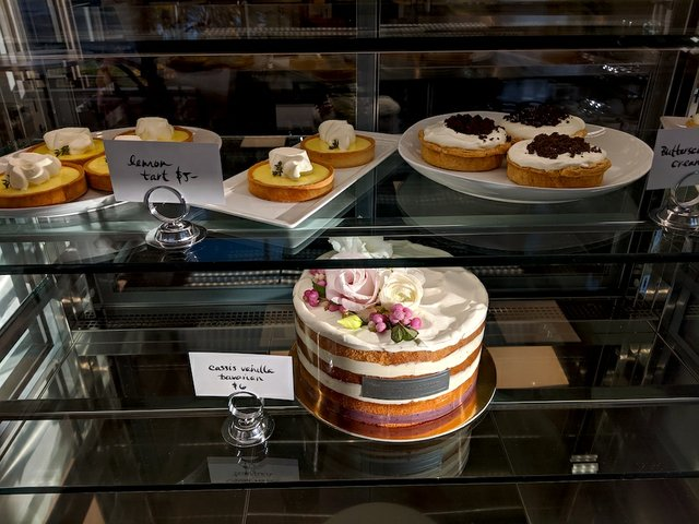 nice looking cakes in a glass case