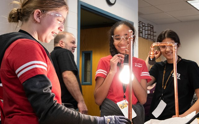Goggle-wearing girls in an afterschool program.