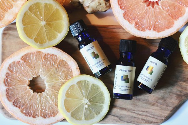 grapefruits and bottles of essential oils