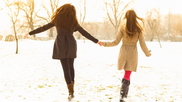 Two women frolicking in the snow