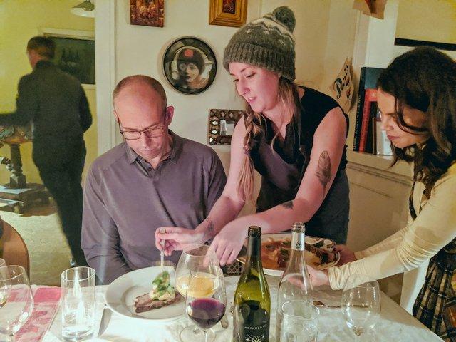 Ingrid Norgaard serves Dan Wick the final pork belly dish