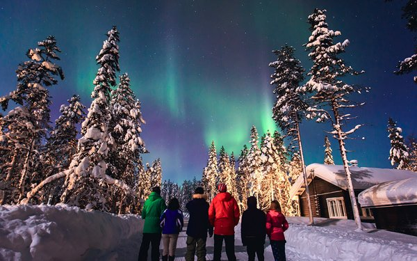 group of six watching northern lights