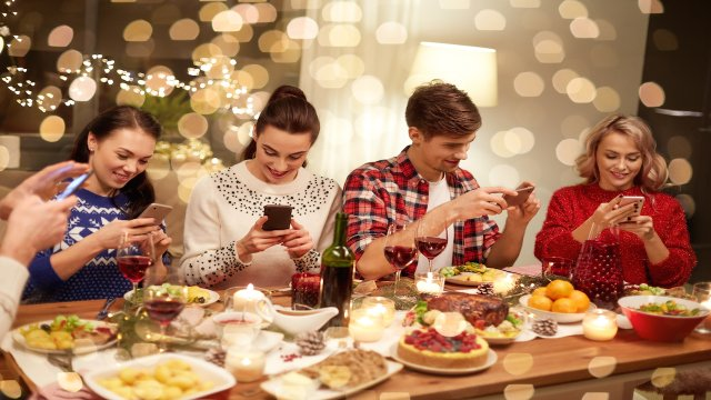 holiday dinner with everybody looking at their phones