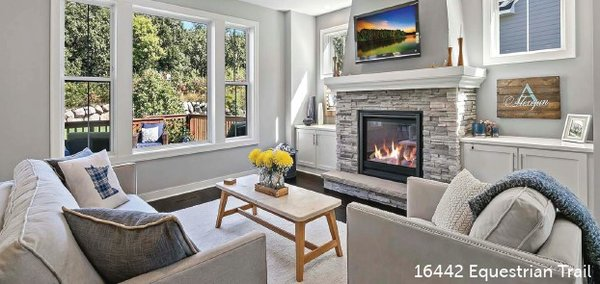 Gray living room with tv and fireplace