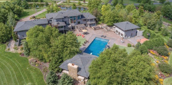 Aerial view of home with guest house and pool