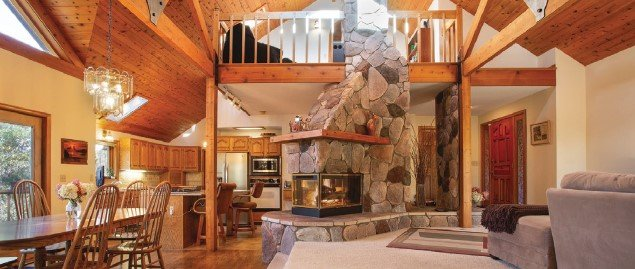 Living and dining room area with stone fireplace