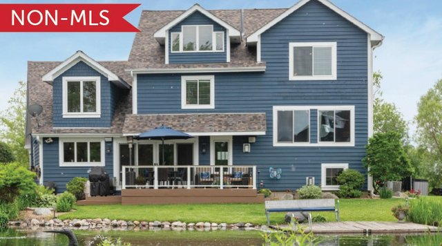 Blue home on lake