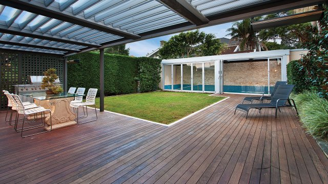 Backyard deck with table and chairs