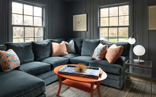 Den with gray sofa and dark gray walls