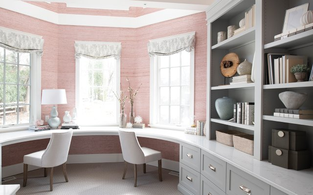 Pink walls and white counters and shelving in office
