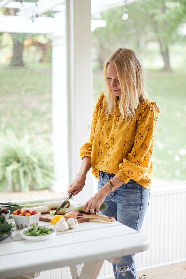 Christina Sandok cutting vegetables
