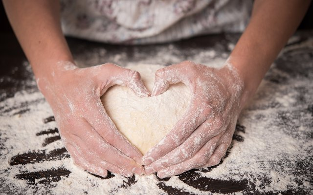 Hands Making Heart Shape with Dough
