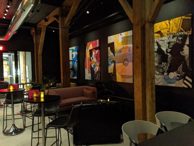 Artwork on the walls of the upper level Stilheart bar.