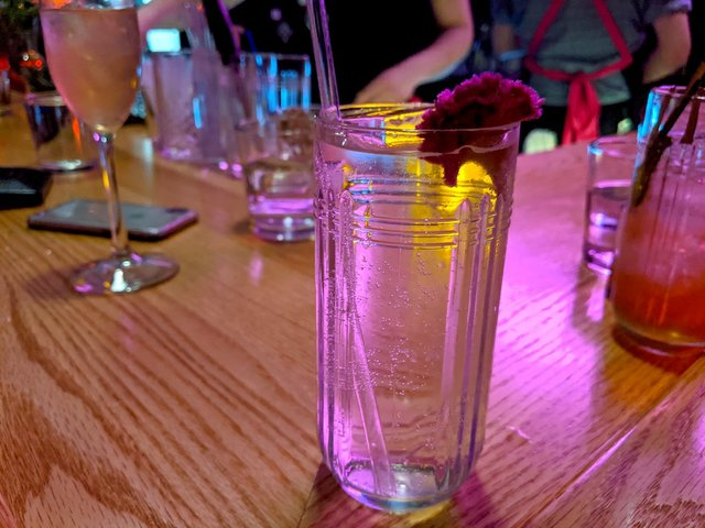 A clear glass with hard seltzer.