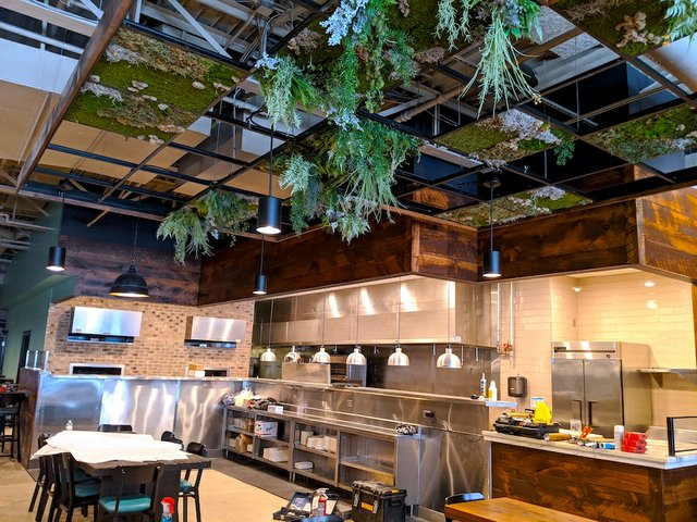 The open kitchen with a chef's table