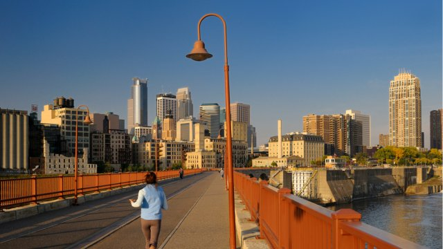 woman runs stone arch in a quiet morning