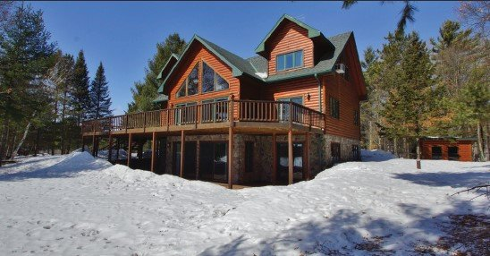 Snowy Exterior of Log Sided Home