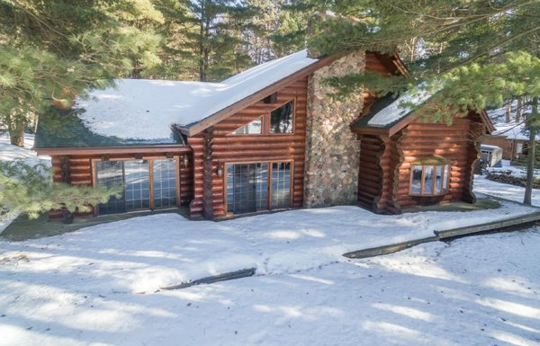 Log home after snowfall