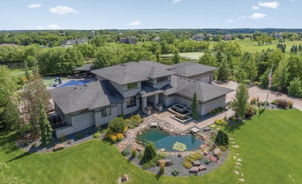 View of suburban home with pool