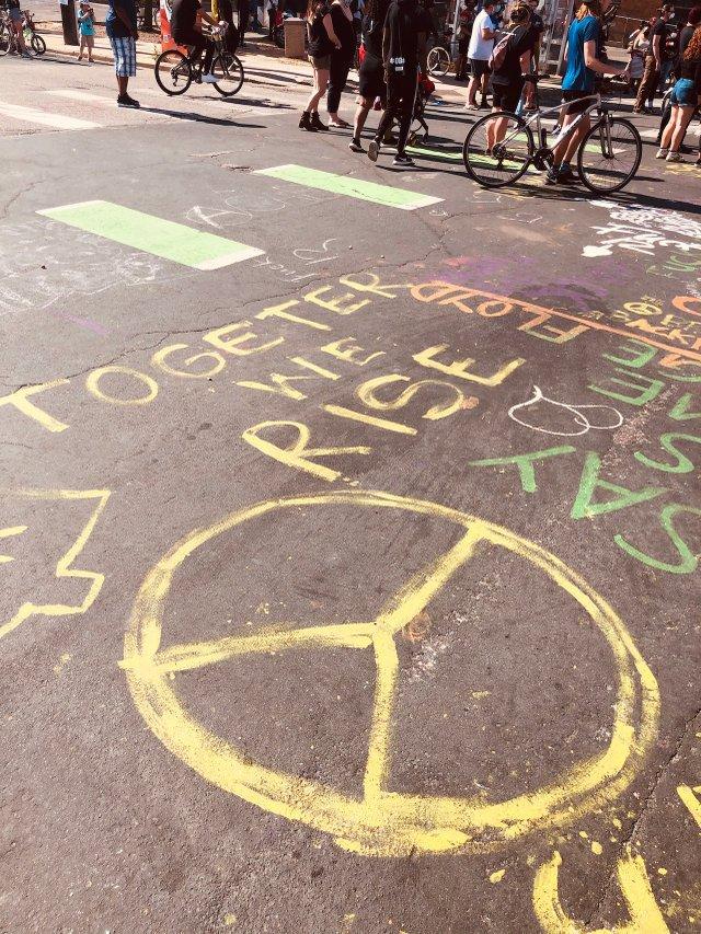 Together We Rise chalk art