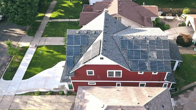 Aerial view of home with solar panels