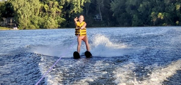 Natalie First Time Waterskiing Peace Sign