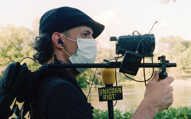 Niko Georgiades covering a march