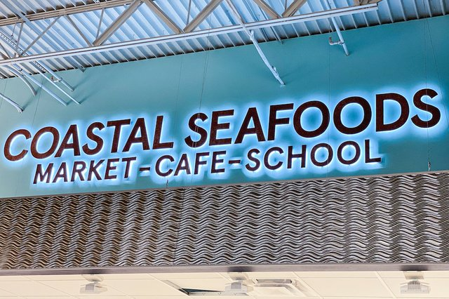 coastal seafoods sign
