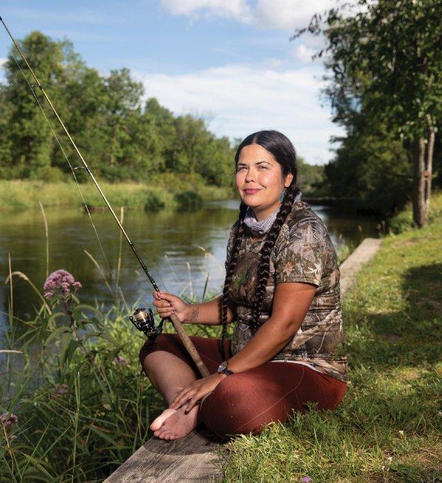 Tara Houska on the bank of a river
