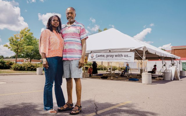 Sondra and Don Samuels with a prayer tent in the background