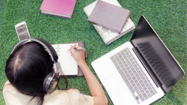 school kid outside on laptop