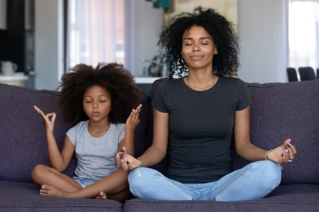 Kid and Parent Meditating Together