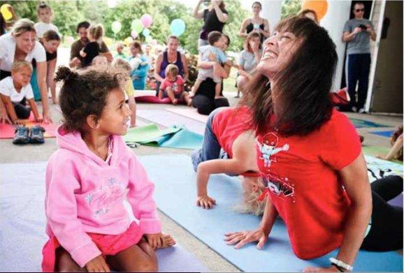 Rosenberg doing yoga with children