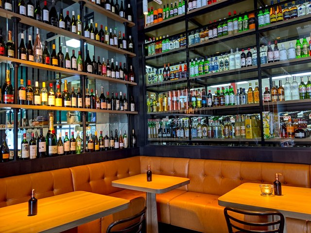 wall of bottles and booths