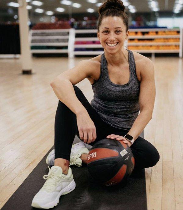 Monica Moreland on mat with ball