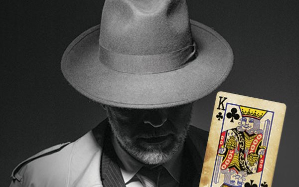 Man in hat with playing card