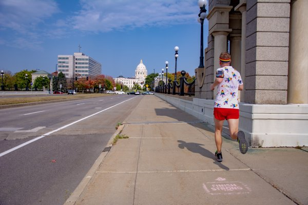 Mikah Meyer Running Toward the State Capitol