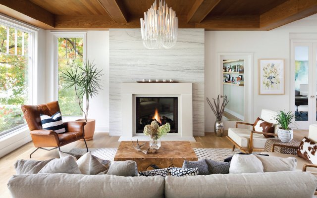 living room with a fireplace in the center