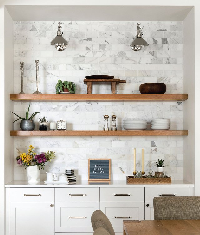 a wall of open shelves and cabinets