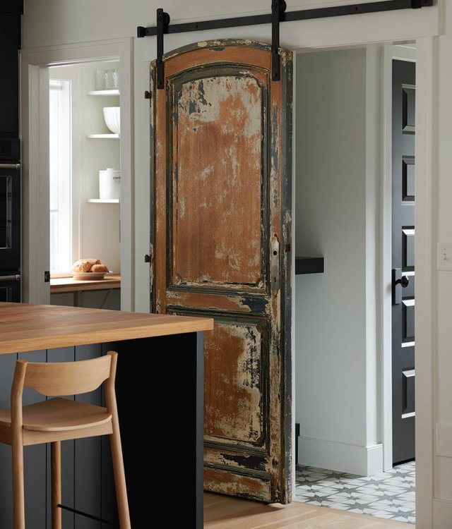 A chipped arch-top door
