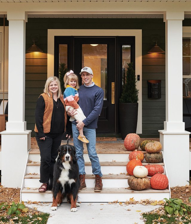 family of three on steps with dog