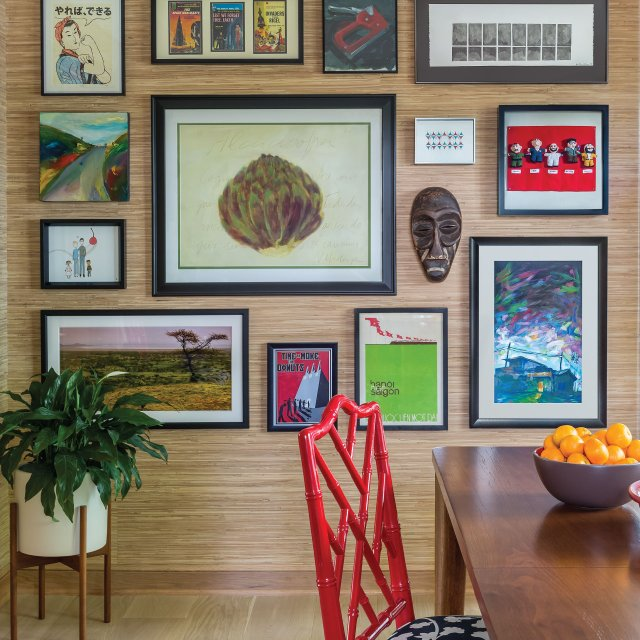dining room wall with art on it