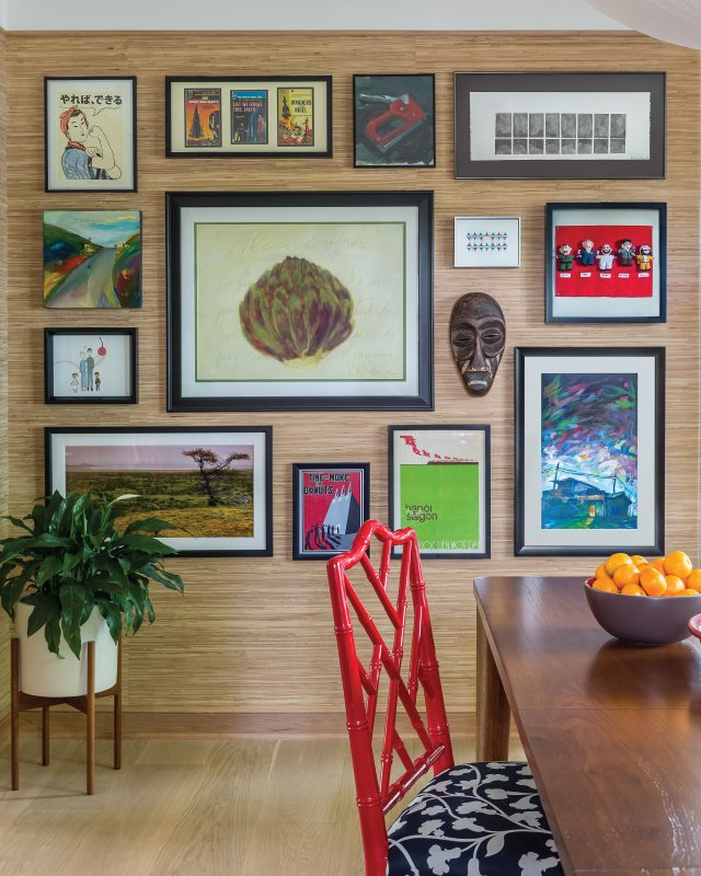 wall in dining room covered in artwork